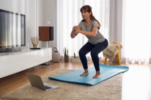 Woman working out in living room.