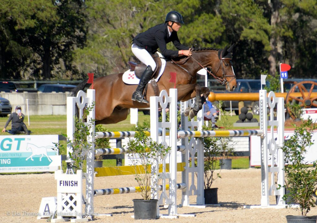 Boyd Martin jumps competing in show jumping.
